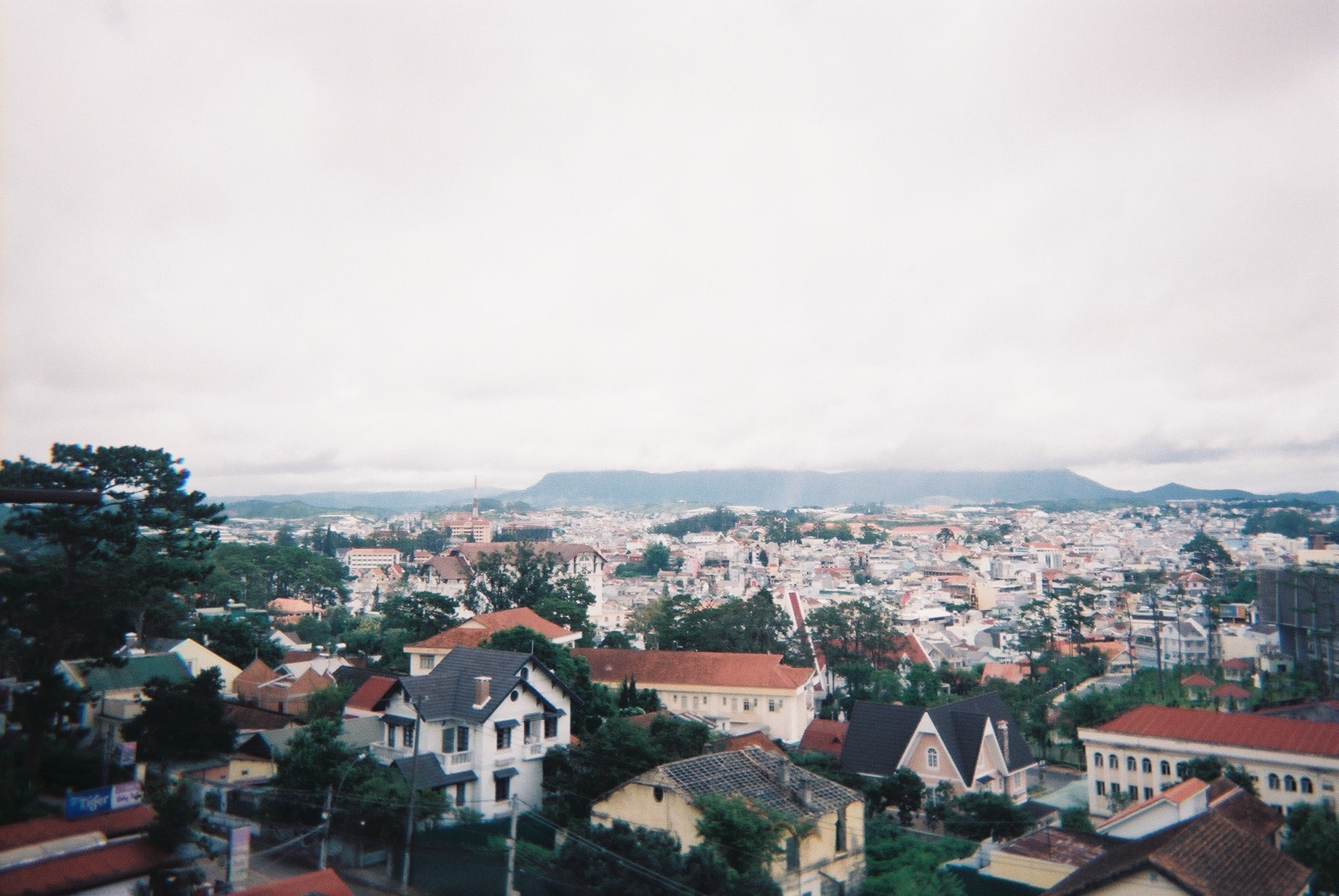film photo of many houses and clouds in vietnam